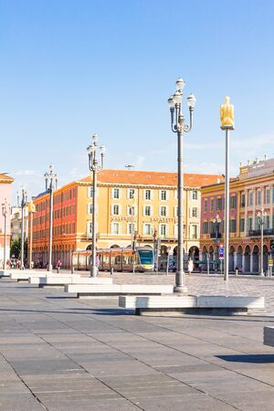 tran: Tourists walking in the Place Massena, Nice, France