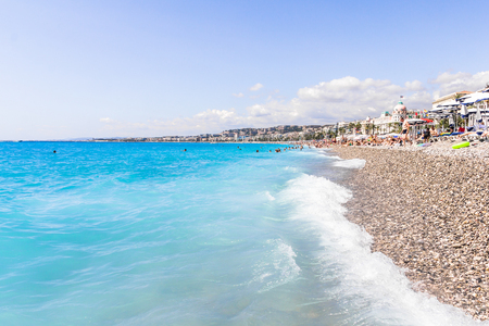 nice france: Tourists enjoy The Good weather at the beach in Nice, France