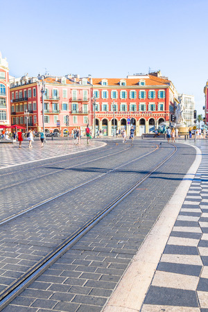 line lines luxury meeting: Tourists walking in the Place Massena in Nice, France