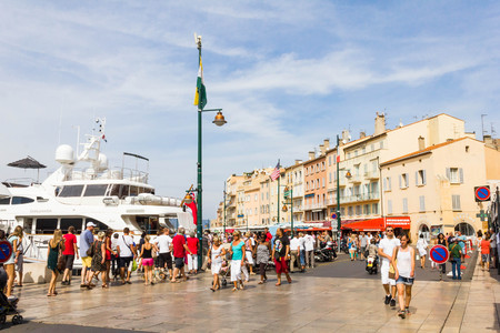 church people: Tourists walking in the old port of Saint Tropez