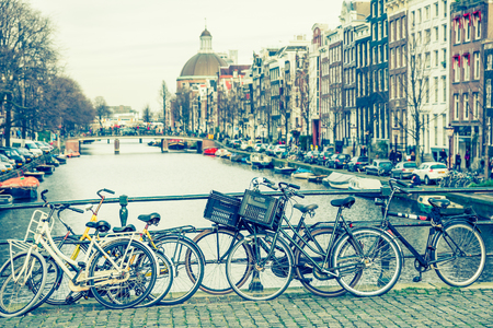 netherlands: Amsterdam canal and bicycles