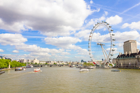 london eye: The London Eye and the Thames river in London