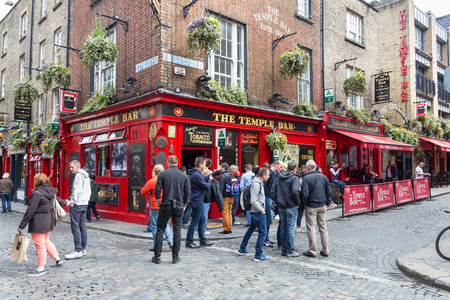 bar area: DUBLIN, IRELAND - 05 MAY, 2016: Tourists walking in the Temple Bar area. The place is the cultural quarter in the center of the city and is full of restaurants, bars and nightclubs.
