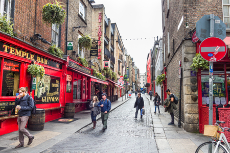 DUBLIN, IRELAND - 05 MAY, 2016: Tourists walking in the Temple Bar area. The place is the cultural quarter in the center of the city and is full of restaurants, bars and nightclubs.