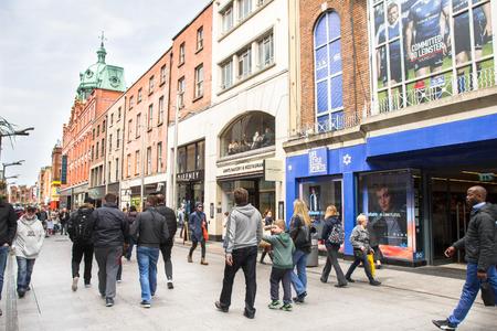 sidewalk: People walking in the Henry Street, Dublin, Ireland