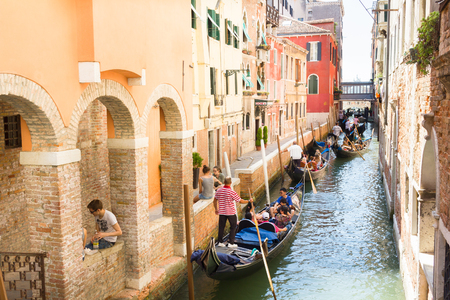 saint mark square: Tourists enjoying the gondolas in a canals of Venice, Italy