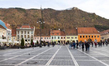 People walking in the Council Square (Pia? A Sfatului), Brasov, Romania