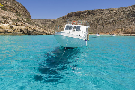 In front of the Baia del Pulcino, the sea is so transparent that the boats do not seem to float, but to fly in the air.