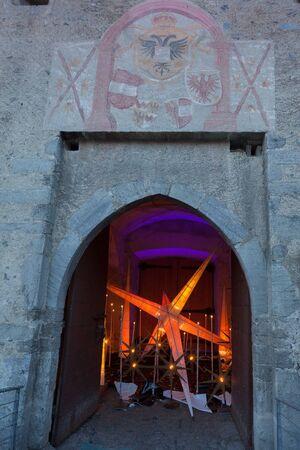 medioeval: GlorenzaGlurns, South Tyrol, Italy, 2016 - 12 10: christmas star into medioeval city gate