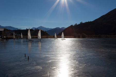 ResiaReschen, Italy - 12 10, 2016: frozen lake with winter sailing boat Stock Photo