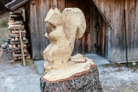 pinecones: Cansiglio, Veneto, Italy; 2016 - 12 30: squirrel wood sculpture