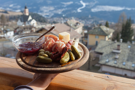 Mountain wooden plate of italian lunch, Fiemme Valley, Trentino, Italy Stock Photo