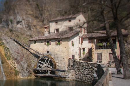 Old mill tilt shift in springtime, Molinetto della Croda, Refrontolo, Treviso, Italy Stock Photo