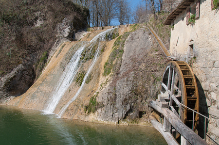 watermill: Ancient mill wheel and waterfall, Molinetto della Croda, Refrontolo, Treviso, Italy