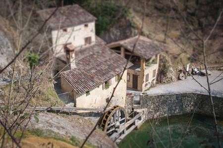 Top view - tilt shift effect of ancient italian watermill Molinetto della Croda, Refrontolo, Treviso, Italy