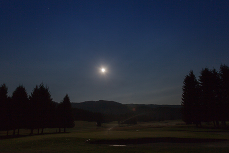 Night view with moon of golf course in Cansiglio Forest, Veneto, Italy