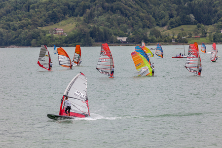 windsurf: FARRA DALPAGO, ITALY  JUNE 30, 2017: 2017 windsurf world championship. Concurrents in action Editorial