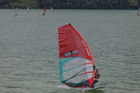 concurrent: FARRA DALPAGO, ITALY  JUNE 30, 2017: 2017 windsurf world championship. German concurrent in action