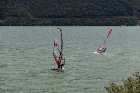 concurrent: FARRA DALPAGO, ITALY  JUNE 30, 2017: 2017 windsurf world championship. Polish concurrent in action Stock Photo