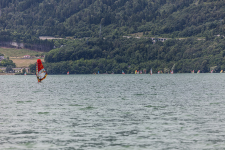 Windsurfers in the Santa Croce lake, Belluno, Italy