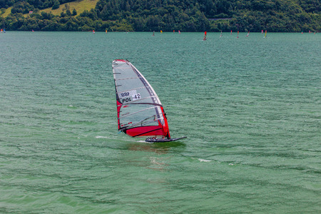 concurrent: FARRA DALPAGO, ITALY  JUNE 30, 2017: 2017 windsurf world championship. Polish concurrent in action Editorial