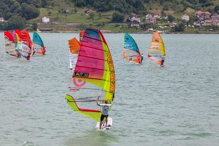 concurrent: FARRA DALPAGO, ITALY  JUNE 30, 2017: 2017 windsurf world championship. Austrian concurrent in action