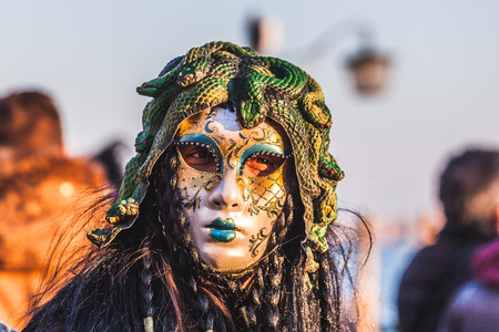 VENICE, ITALY - FEBRUARY 10 2018: Close up of carnival masks dressed as Medusa Stock Photo - 98563054