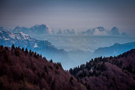 Sunrise on snow-covered Mount Civetta peaks dipped in the mist, Dolomites, Veneto, Italy Stock fotó