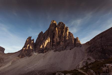 Last rays of sun that illuminate a beautiful Dolomite peak Фото со стока