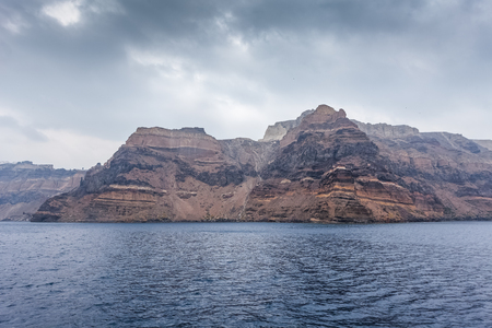 Panorama of the colorful cliff of caldera in the island of Santorini, Greece Фото со стока