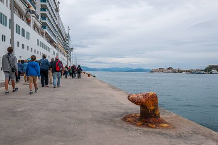 Passengers boarding a cruise ship