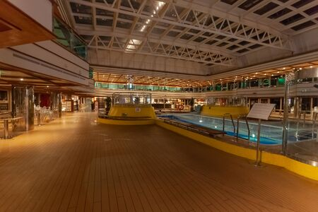 Night view of the indoor pool of a cruise ship