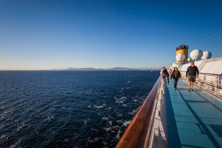 Top paddle of cruise ship just set sail from Athens with passengers