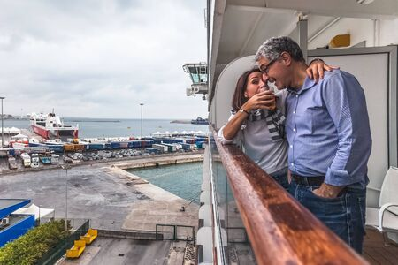 Couple drinking a drink on the deck of a cruise ship Stock fotó