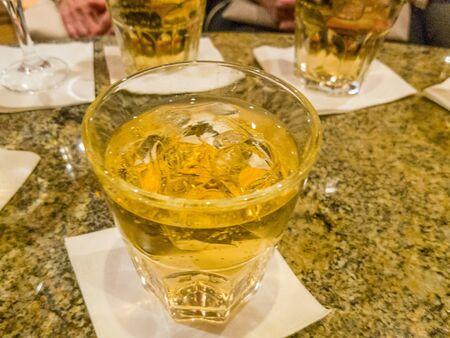 Glasses of ginger ale on marble table Reklamní fotografie
