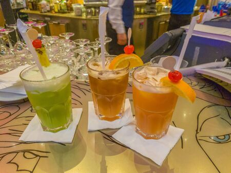 Different types of fruit cocktails on a bar counter