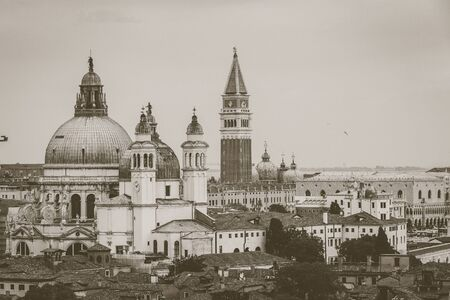 Aerial vintage view of Basilica della Salute and San Marco bell tower, Venice