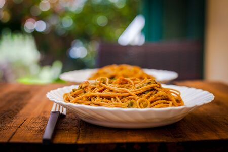 Plate of wholemeal spaghetti with tuna and olives