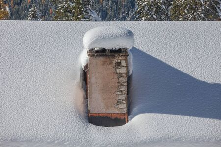 Alpine hut roof with snow-covered fireplace, Val Fiorentina, Dolomites