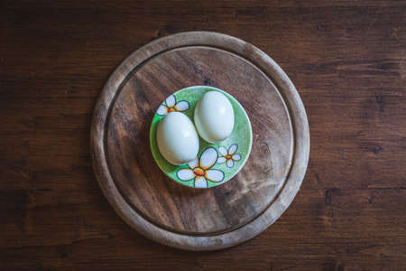 Top view of pair of eggs on rustic wooden plate. Concept: vegetables, work in the kitchen, natural food Stockfoto