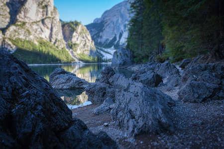 Tilt shift effect of Braies lake beach covered of boulders 写真素材 - 151089493
