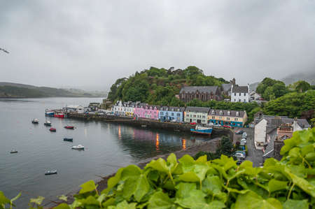 Beautiful panorama of Portree in a rainy day, Skye Island. Concept: travel in Scotland, Scottish landscapes and villages