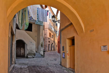A narrow street among the old houses of Maranola, a medieval village in the Lazio region, Italy.