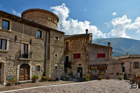 A narrow street among the old houses of Villalago, a medieval village in the Abruzzo region.
