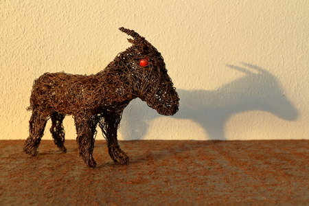 nanny goat: A goat toy made of metal wire