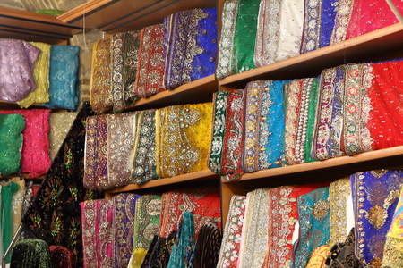 gold souk: Stack of colored cloths in Iran Stock Photo