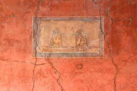 Pompeii, Italy: fresco paintings on ancient Roman walls Stock Photo