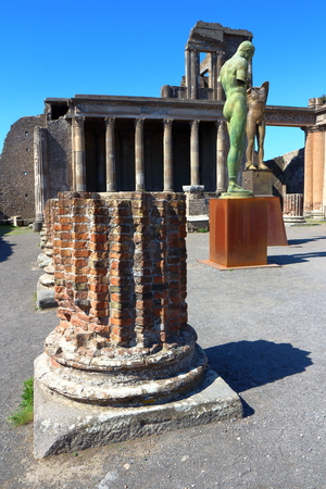 Pompeii, Italy - March 28, 2017: Sculptures of the Polish sculptor Igor Mitoraj on display at Pompeii archaeological site, the ancient Roman city, destroyed in 79 BC by the eruption of Mount Vesuvius.