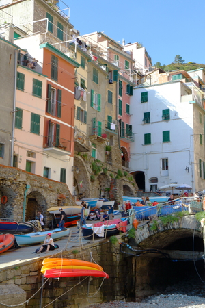 Riomaggiore, Italy - May 16th, 2017: view of Riomaggiore, one of five famous centuries-old colorful villages of Cinque Terre National Park in Liguria, region of Italy.