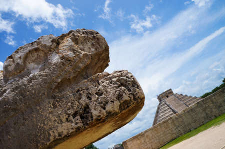 a mexican sculputure with the temple of Kukulkan situed in the archaeological site of chichen itza, Yucatan, Mexico. photo